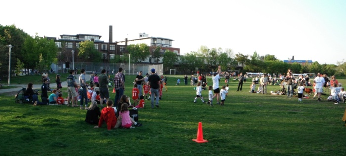 Photo of kids and parents playing soccer at Sorauren Park