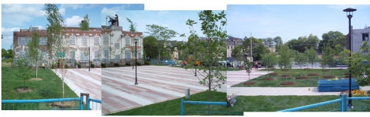 Photo of Phase 1 of the Sorauren Park Town Square almost complete, showing hard-surface pavers, black light standards and surrounding lawn and trees