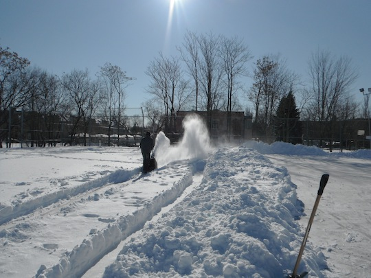 Clearing the snow off the rink after big storm