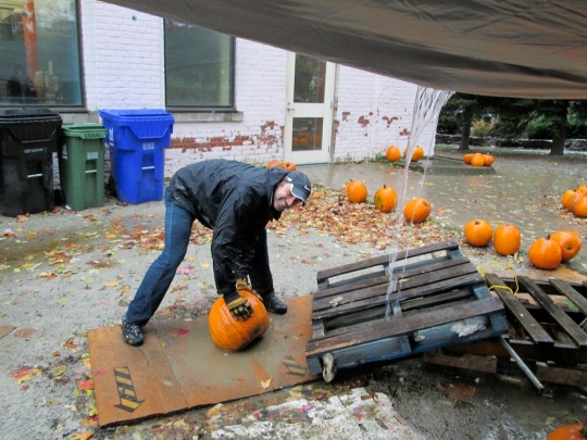 Washing pumpkins at the pumpkin sale