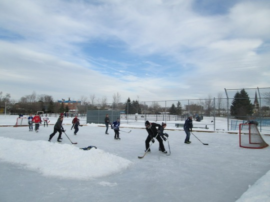 Shinny hockey at Soraruen Park rink, blue skies