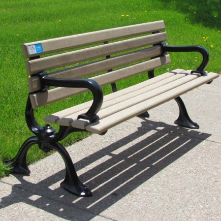 Picture of park bench with black armrests and legs