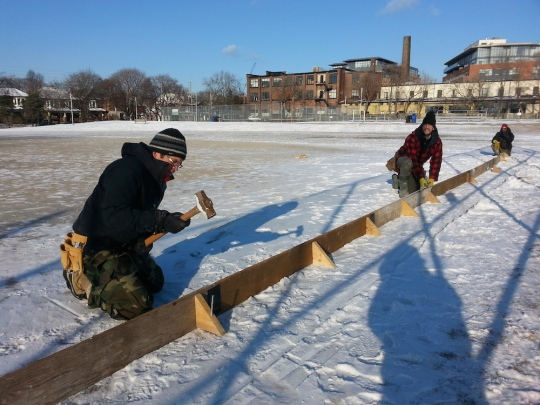 Installing the rink boards (keeps water in) for last year's rink