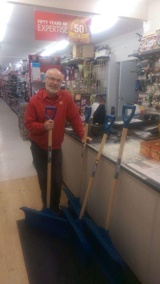Len McAuley lends a hand with a donation of shovels and salt for the Sorauren rink
