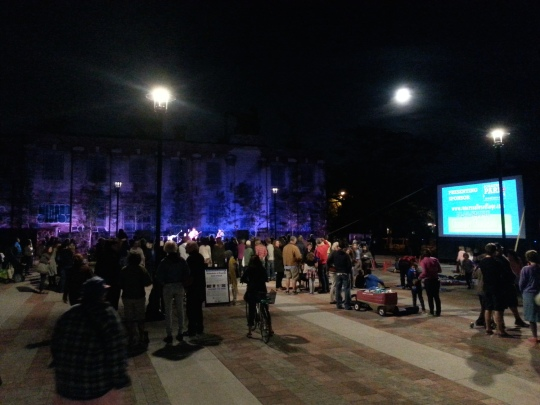 Full moon rises over the Paul James Bank rocking the Town Square as the movie warms up. Photo by Wabash Building Society.