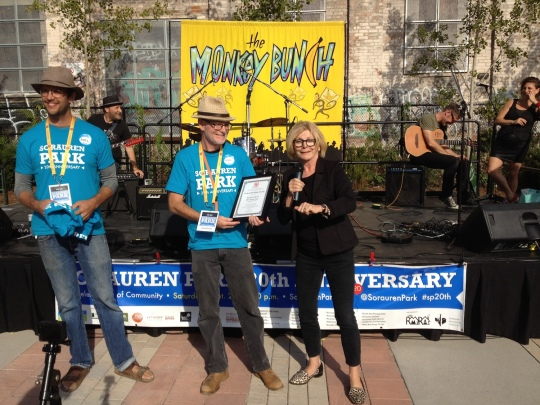 Parkdale-High Park MPP Cheri DiNovo presents a plaque to outgoing Wabash Building Society chair Doug Bennet and incoming chair Joël Campbell