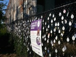 Photo of thousands of keys on fence outside future Wabash Community Centre