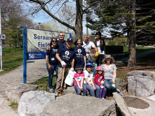 Volunteers, young and old, pose for a photo at the Sorauren Park Fieldhouse Gardening Day