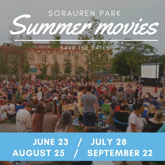 Photo of large audience at Sorauren Park settling in to watch outdoor movie on inflatable screen